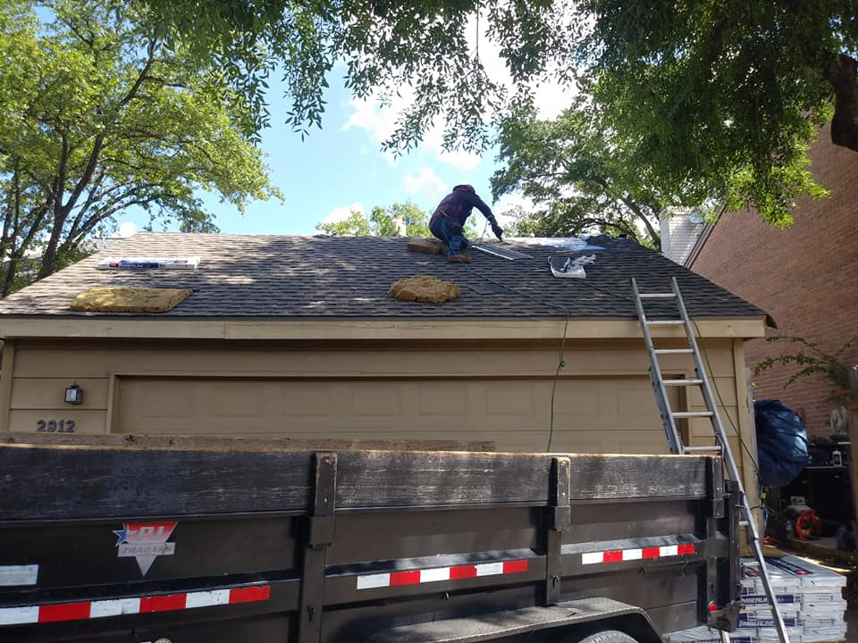 roofing contractor installing roof